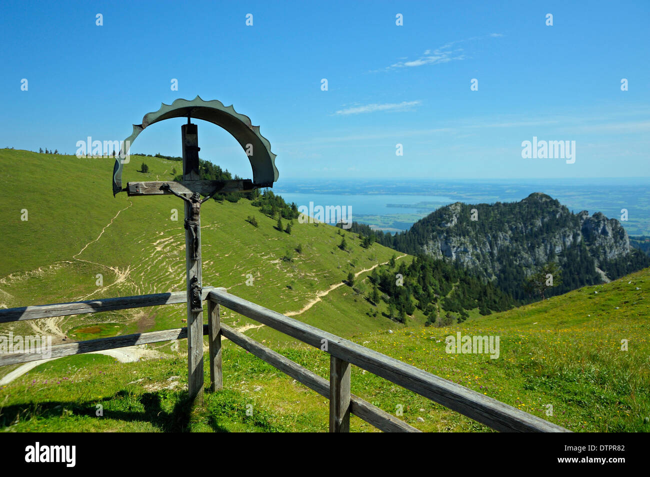 Crucifix at Steinling chapell, view to lake Chiemsee, Steinlingalm, Kampenwand, Bavaria, Germany / cross - Stock Image
