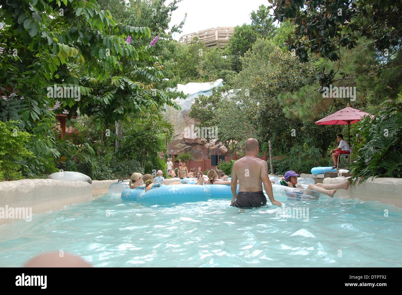 Tourist Enjoying The Lazy River At Walt Disney World Blizzard Beach