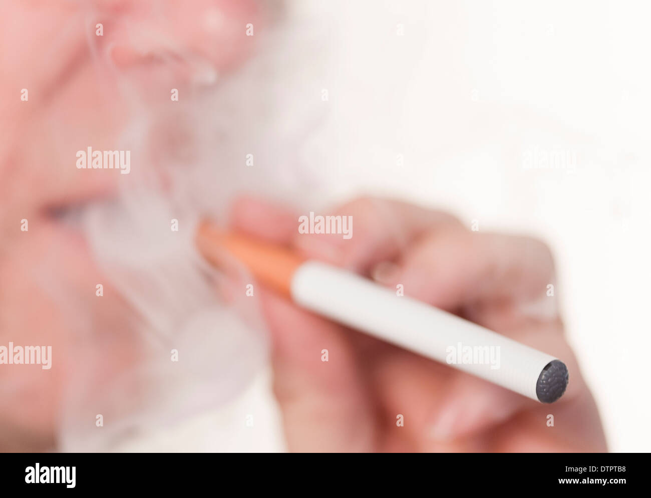 smoking or vaping an E or electronic cigarette - Stock Image