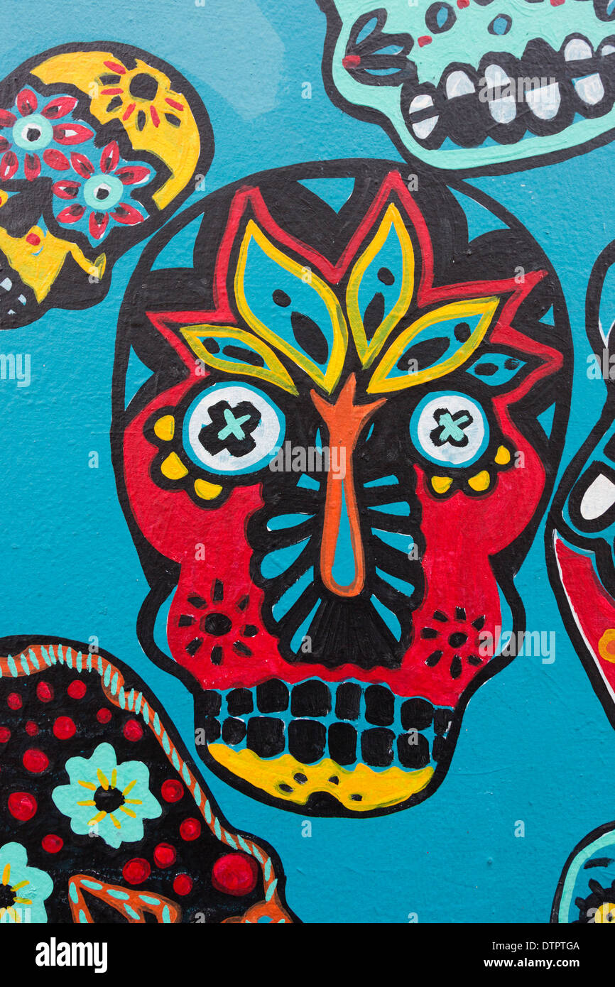 Colourful skull graffiti on a wall in Camden Town by Faye Suzannah and Helen Wheels, London, England, United Kingdom, UK - Stock Image
