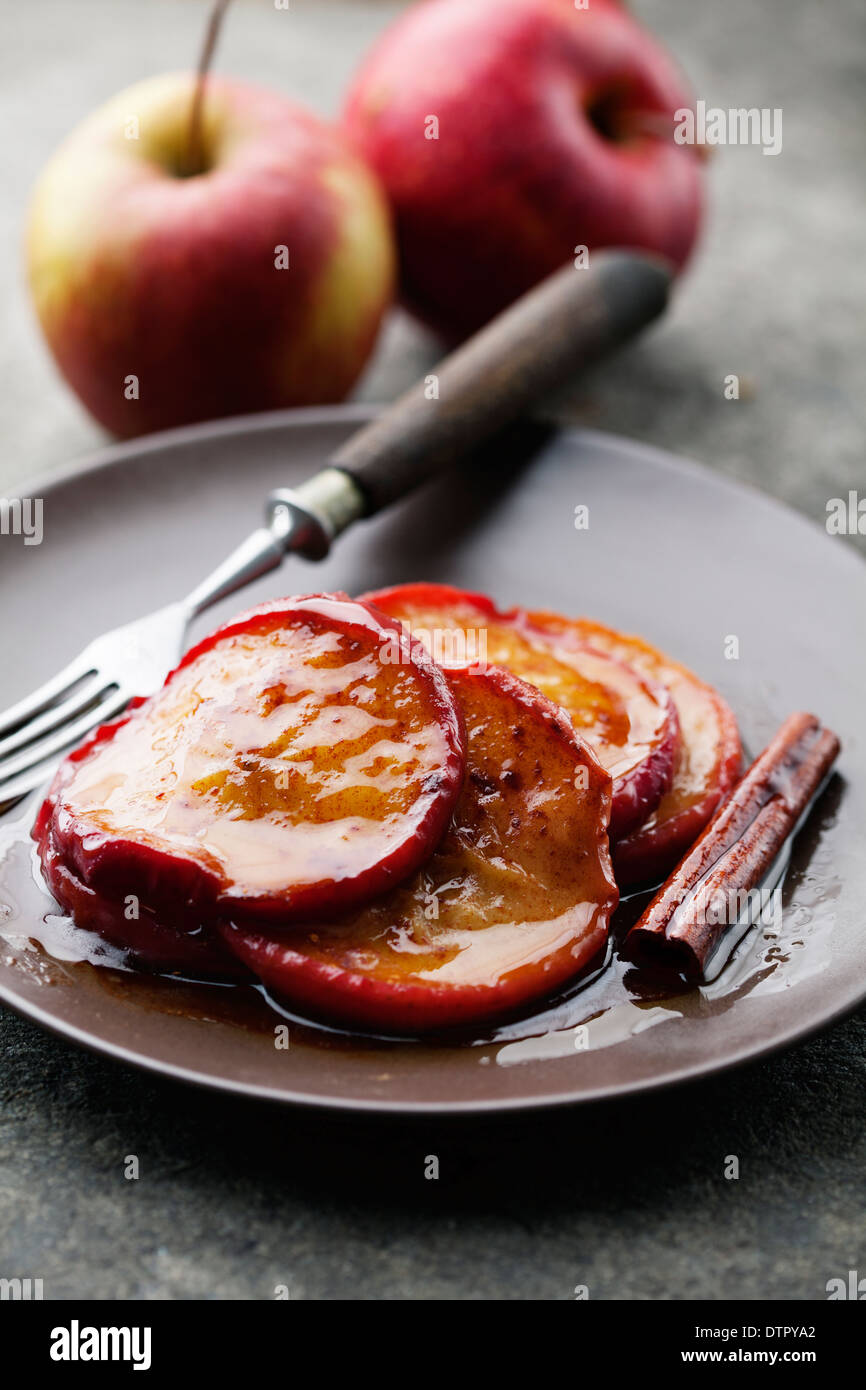 apples cooked with brown sugar, butter and cinnamon - Stock Image