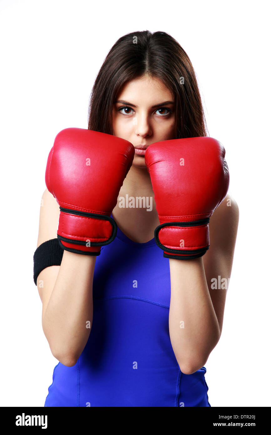 Young beautiful sport woman standing with boxing gloves isolated on gray background - Stock Image