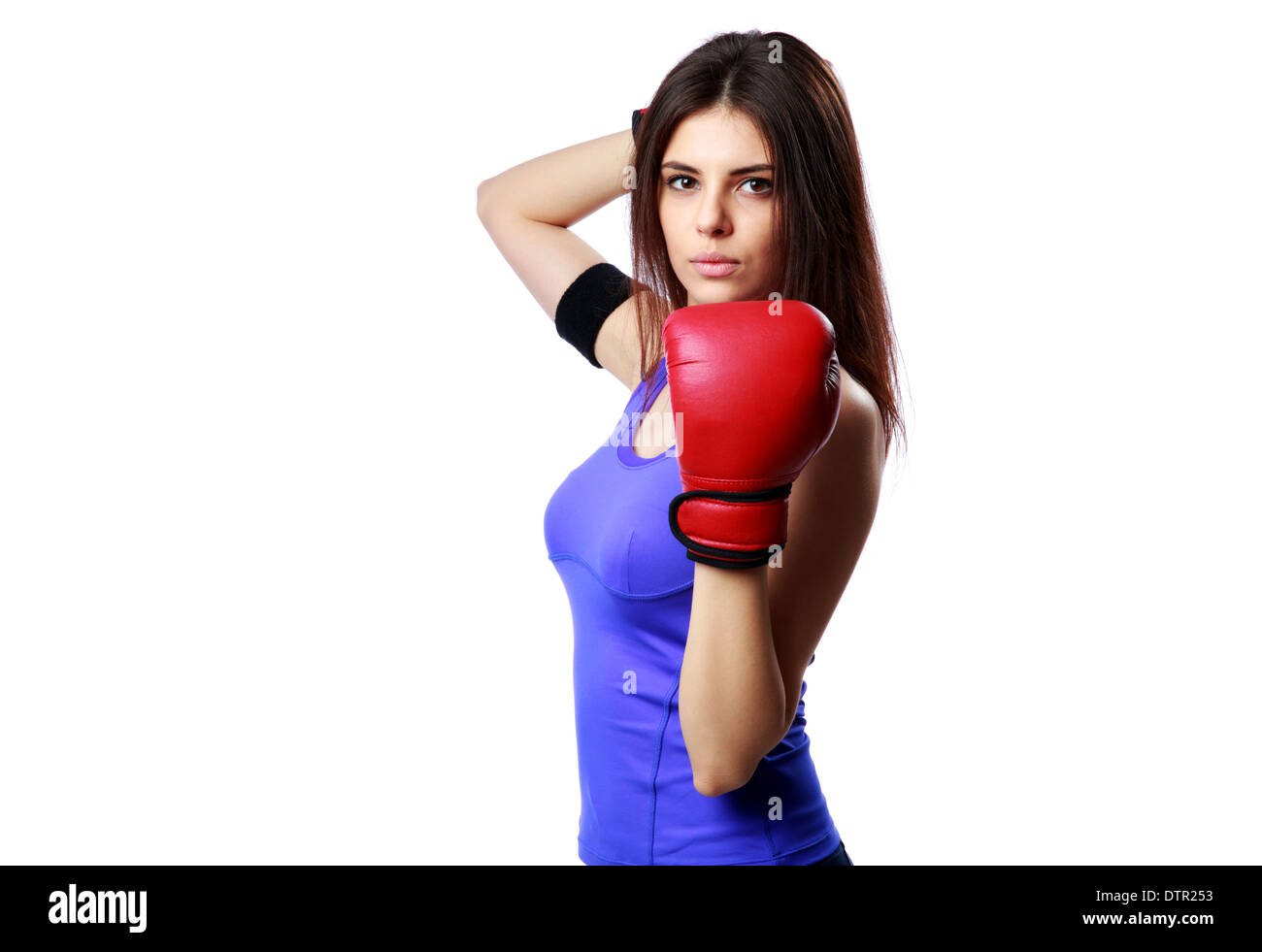 Young confident sport woman standing with boxing gloves isolated on gray background - Stock Image