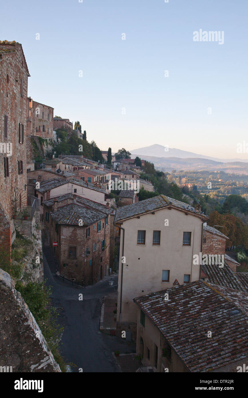 View over the rooftops of Montepulciano to the countryside beyond.  Tuscany, Italy. Mandatory credit Jo Whitworth - Stock Image