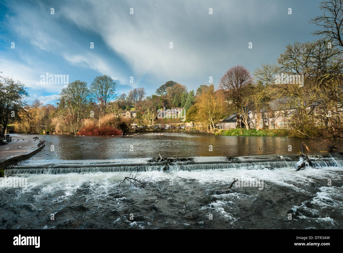 Rough, fast flowing high water on the river Wye, Bakewell. - Stock Image