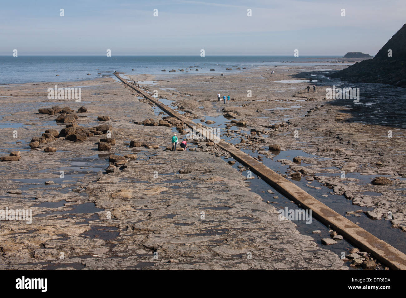 Waste Pipe Sea Bound and Tourists, Whitby, East Yorkshire, England - Stock Image