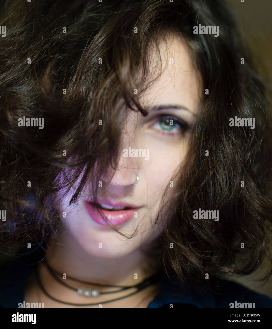 Portrait of a young woman in her early 20s Model release available - Stock Image