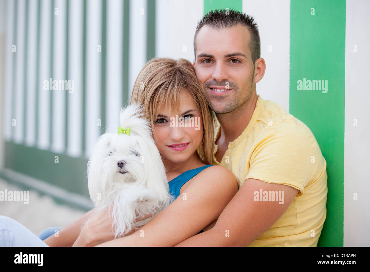couple with pet dog Stock Photo