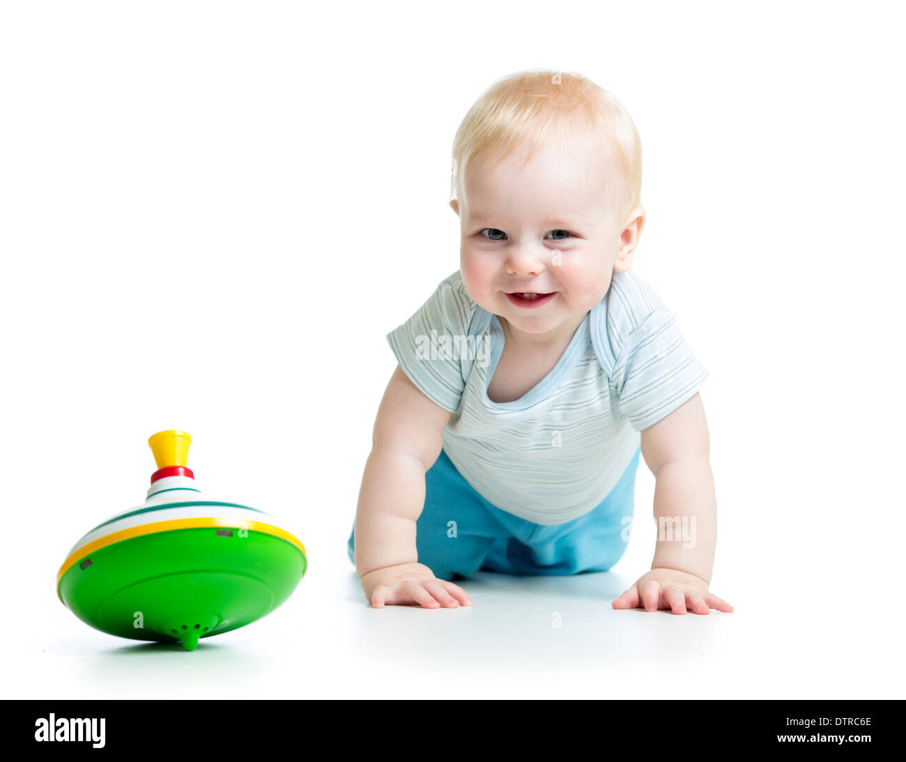 baby playing with toy whirligig - Stock Image