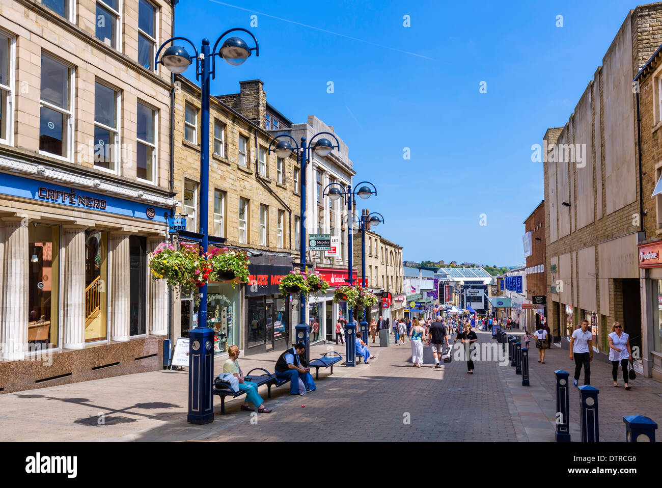 Shops on King Street in the town centre, Huddersfield, West Yorkshire, England, UK - Stock Image