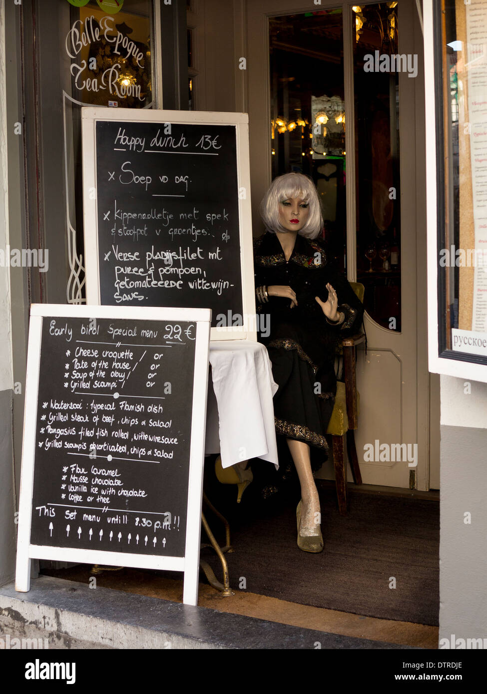 Menu blackboards and a glamourous mannequin at the entrance to Bell Epoque tearoom on Zuidzandstraat, Bruges (Brugge) - Stock Image