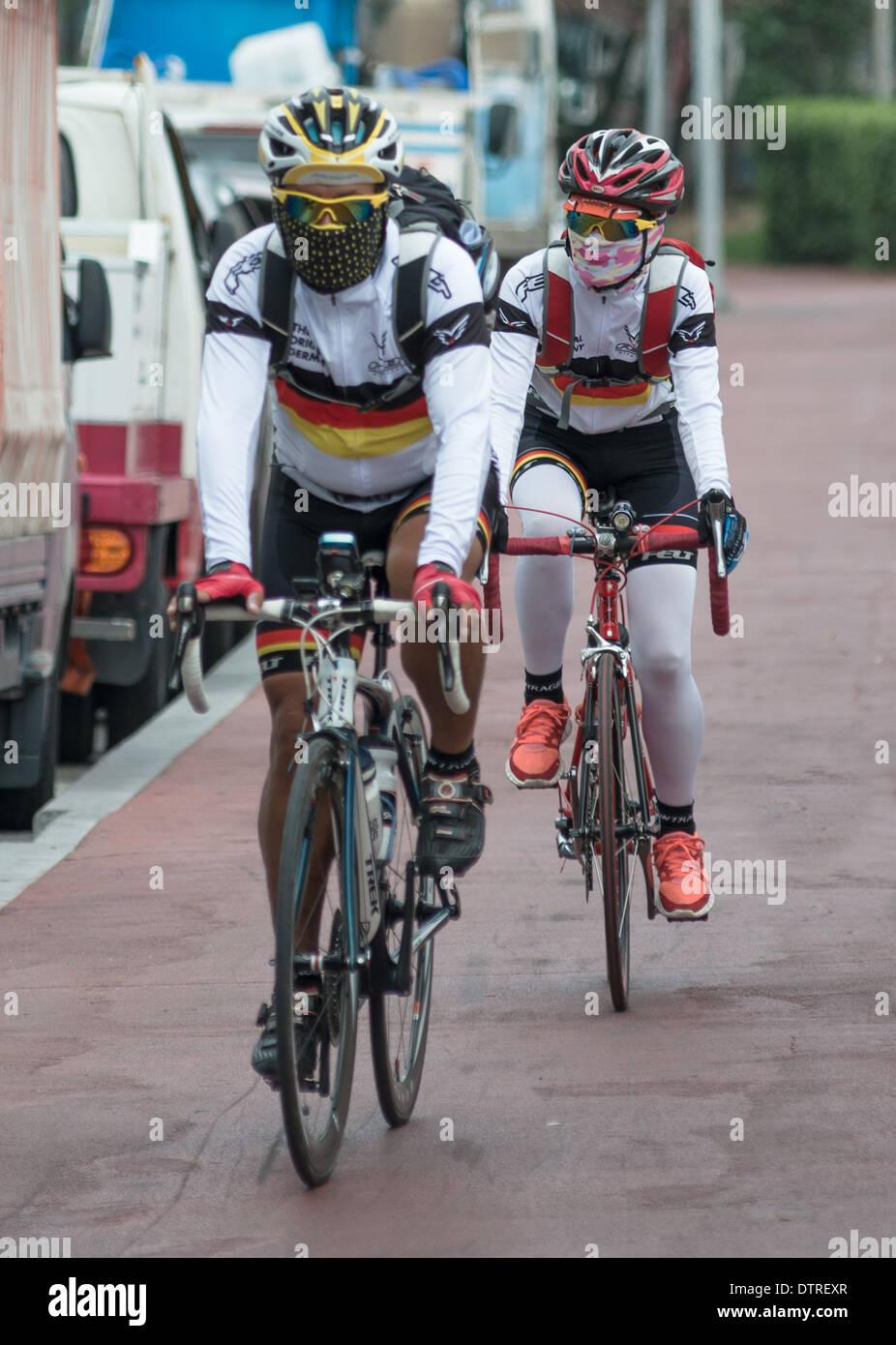 Masked South Korean Cyclists, Busan, South Korea, 2014 - Stock Image