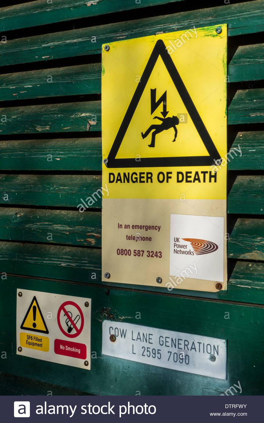 Warning signs on electricity generation plant in Godmanchester, Cambridgeshire, UK - Stock Image