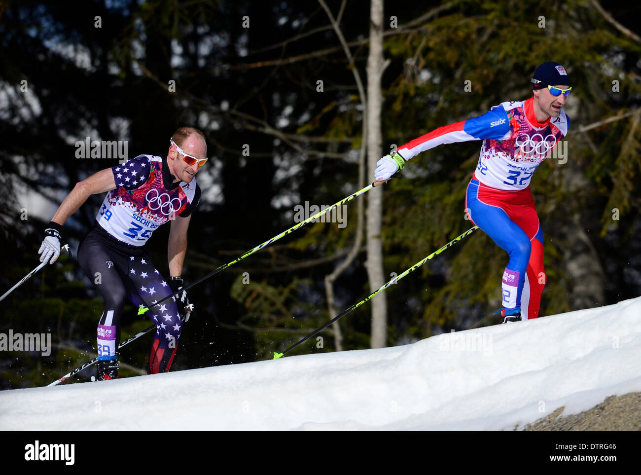 Sochi, Russia. 23rd Feb, 2014. Jiri Magal (CZE) (right) and Toni Livers (SWI) compete during the men's 50 KM cross country at the 2014 Winter Olympics, Sunday, February 23, 2014, in Krasnaya Polyana, Russia. Credit: Roman Vondrous/CTK Photo/Alamy Live News - Stock Image