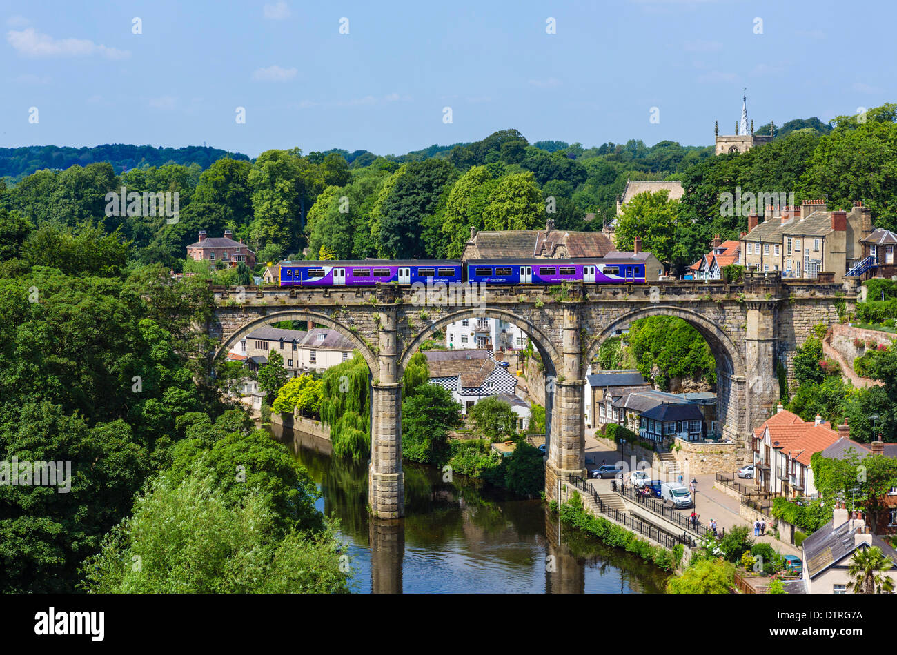 Northern Rail train on the viaduct over the River Nidd, viewed from the Castle, Knaresborough, North Yorkshire, England, UK - Stock Image