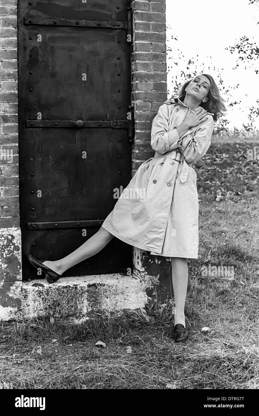 Sixties fashion model with raincoat - Stock Image