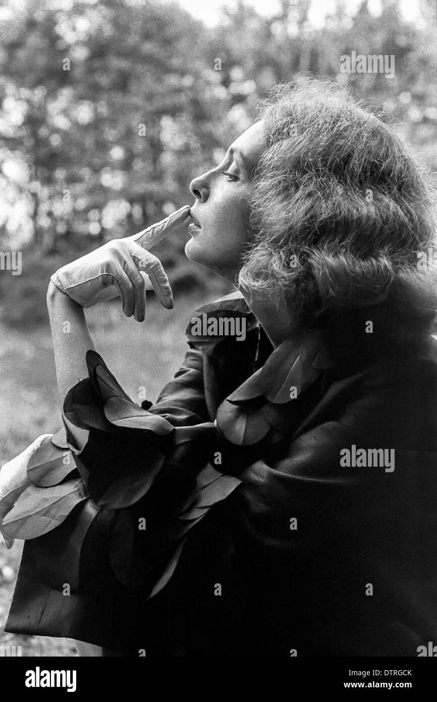 Sixties fashion model portrait with black coat - Stock Image