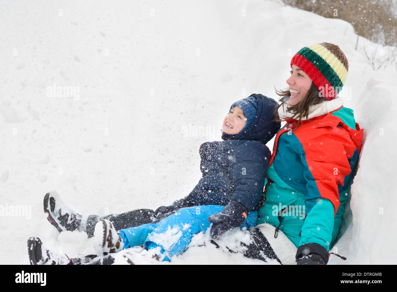 Moher and Son in Wintertime playing in snow - Stock Image