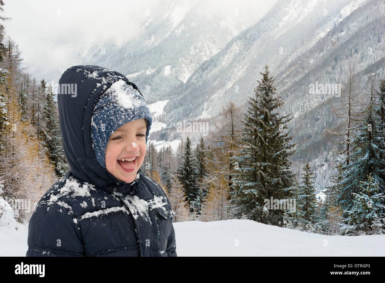 Happy child in wintertime in mountain resort - Stock Image