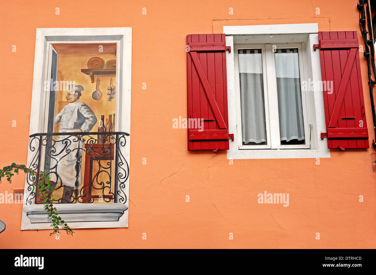 Wallpainting and window, Chalamont, Ain, Rhone-Alpes, France - Stock Image