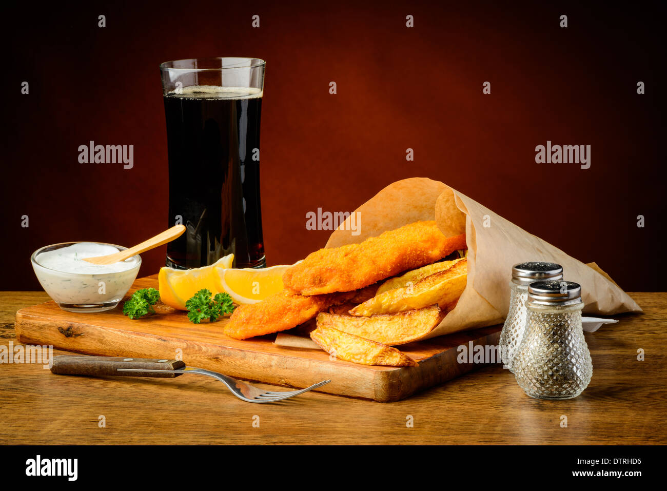 still life with fish and chips menu and cola drink - Stock Image