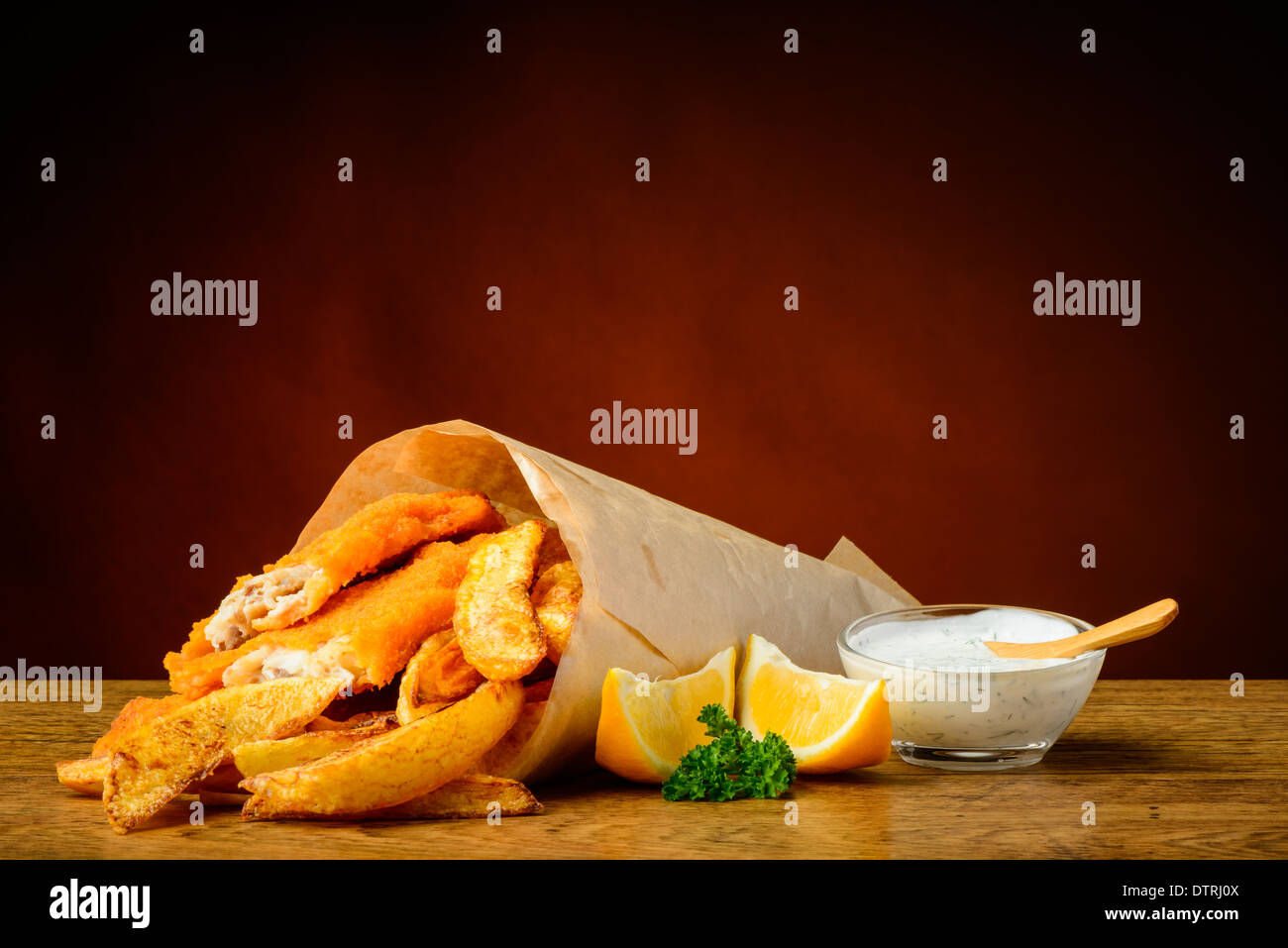 still life with traditional fish and chips menu, lemons and dip sauce - Stock Image