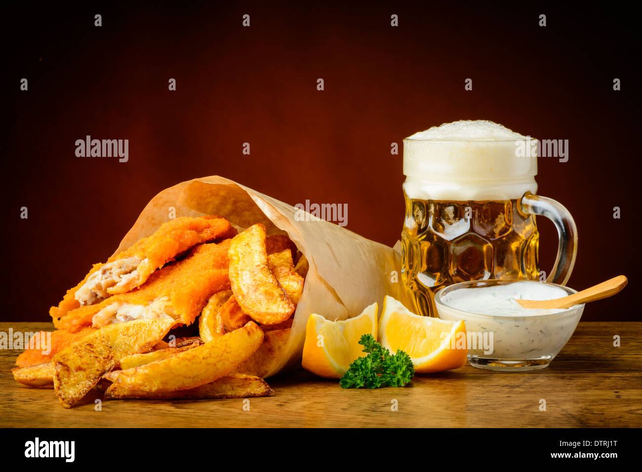 still life with traditional homemade fish, chips and beer - Stock Image