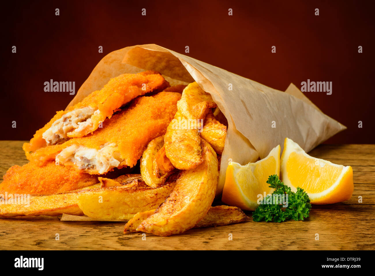 still life with traditional fish, potato chips and lemons - Stock Image