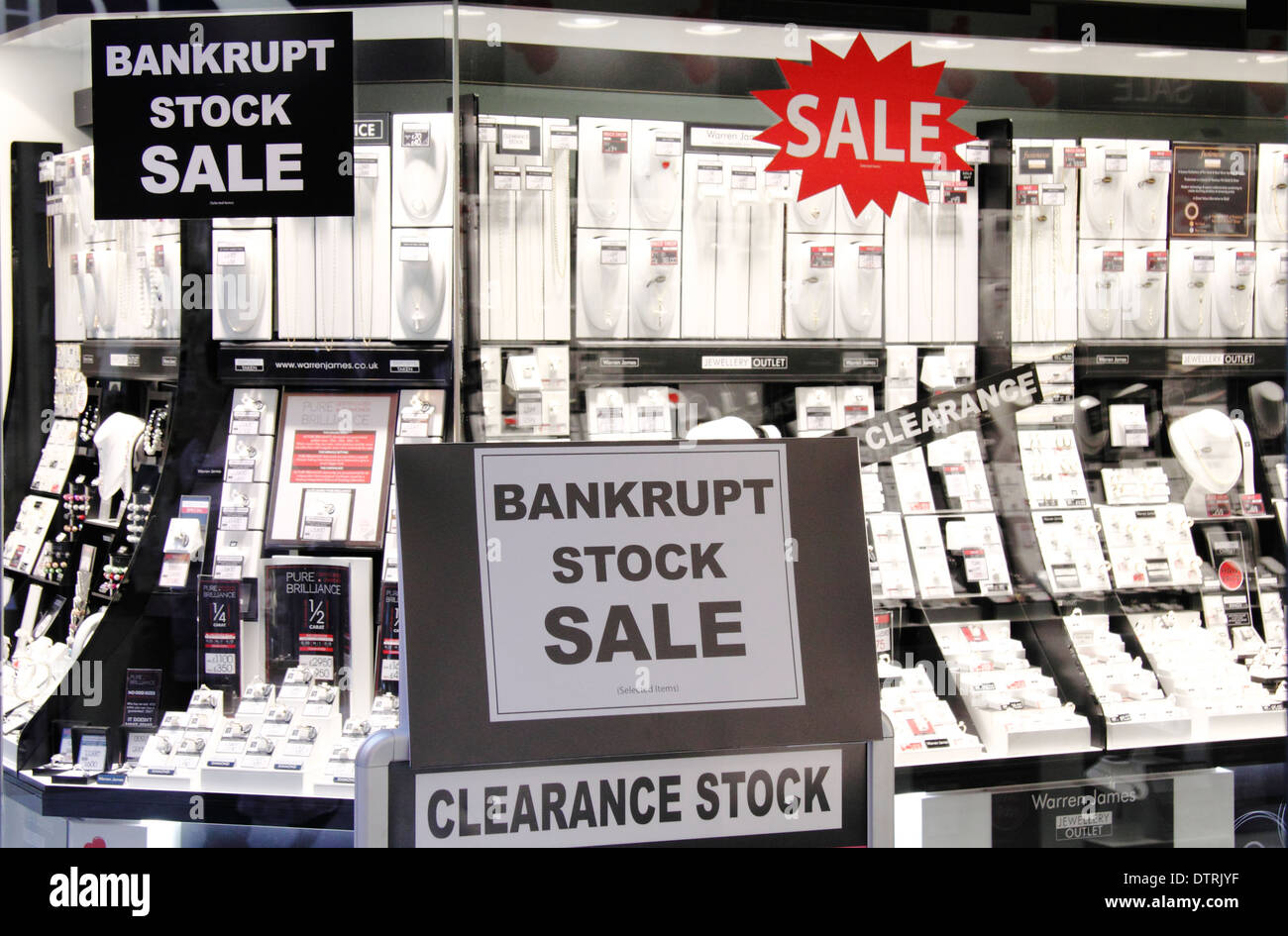 Bankrupt stock sale and clearance stock sale advertisement in window of a jewellers shop in England, UK - Stock Image