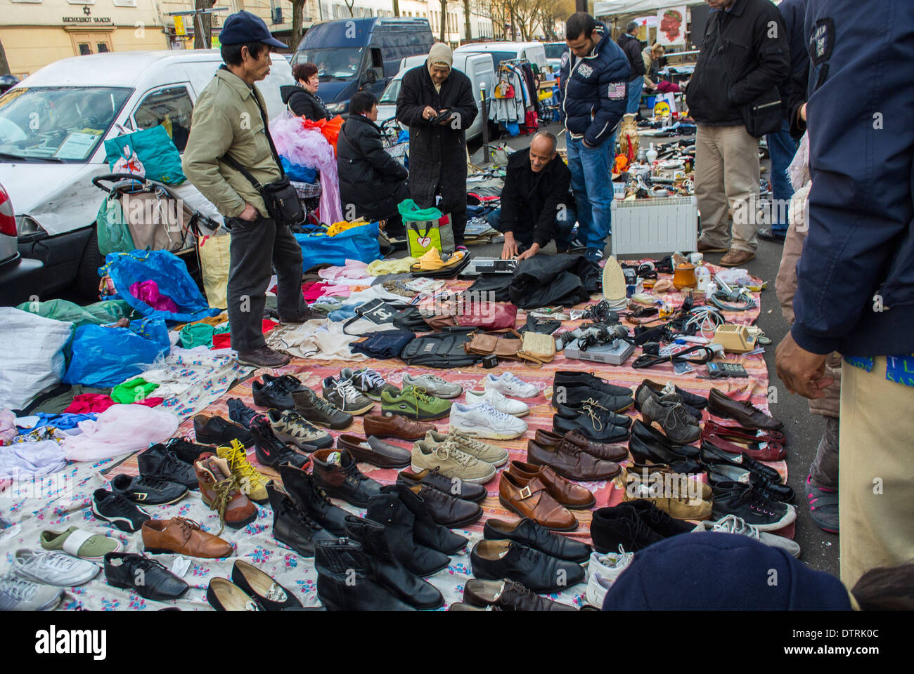 Paris, France., Immigrant Chinese Merchants, French Flea Market in Belleville District, Immigrants Selling Used Stock Photo