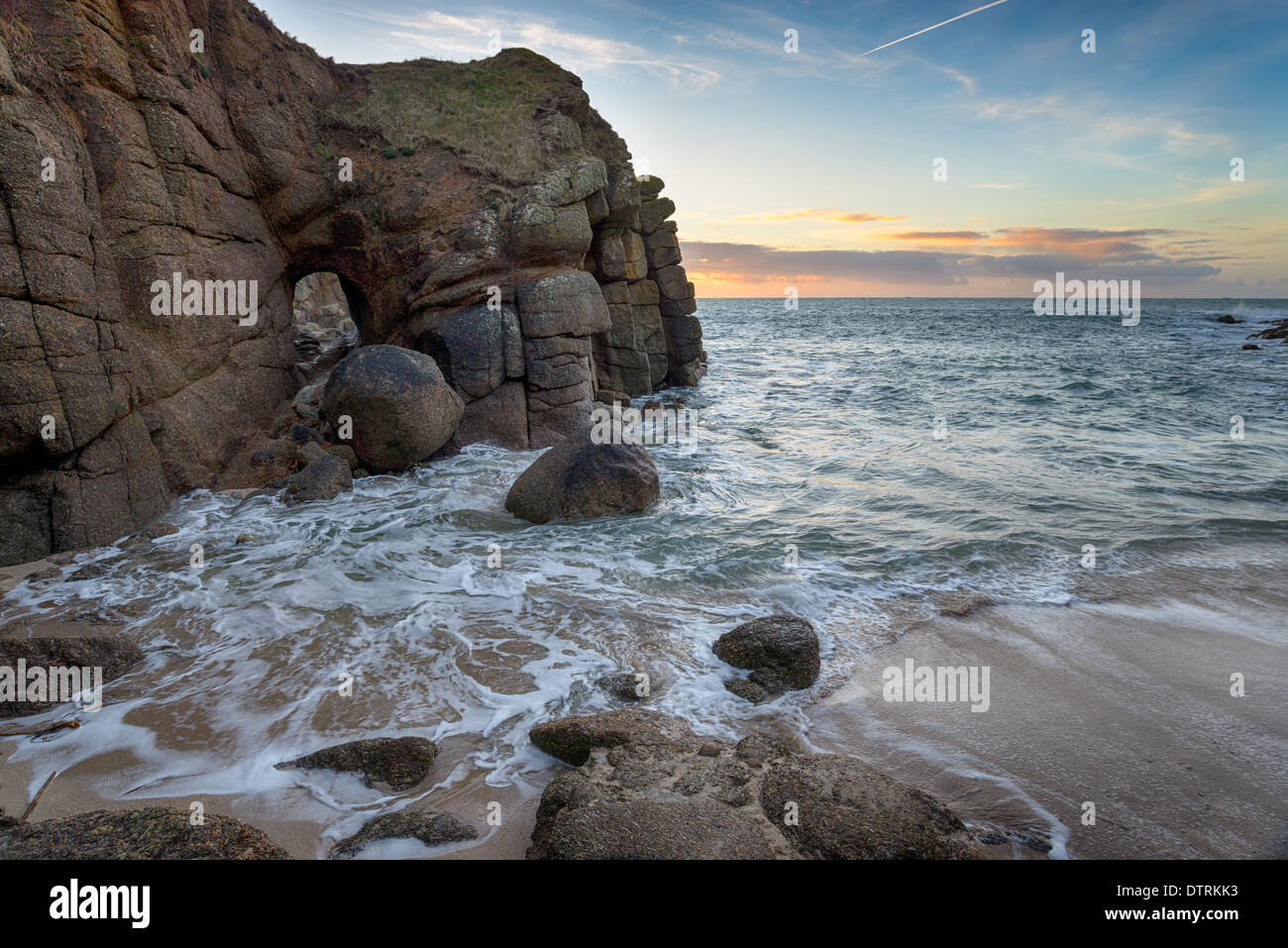 Cliffs and sea caves at Porthqwarra Cove on the Lands End Peninsula near Penzance - Stock Image