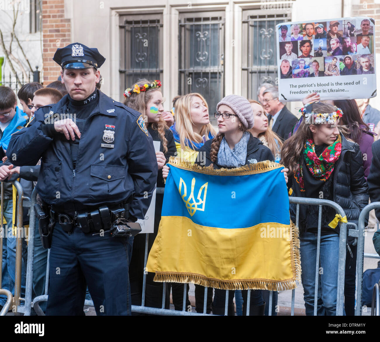 New York, USA. 23rd Feb, 2014. Ukrainian-Americans and their supporters rally in front of the Ukrainian Mission Stock Photo