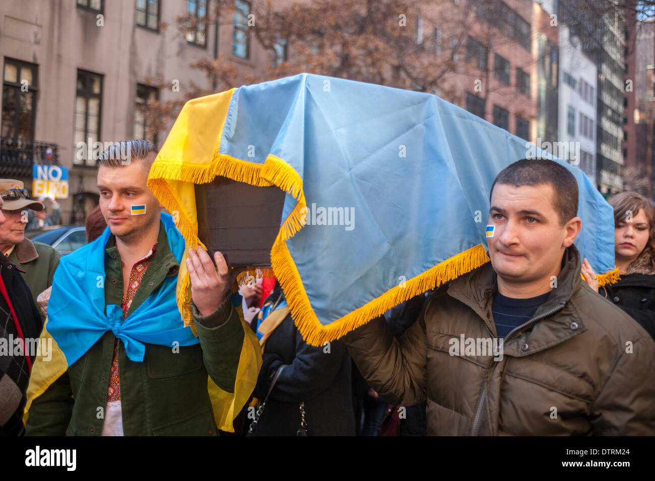 New York, USA. 23rd Feb, 2014. Ukrainian-Americans march with a mock casket at a rally in front of the Ukrainian Stock Photo
