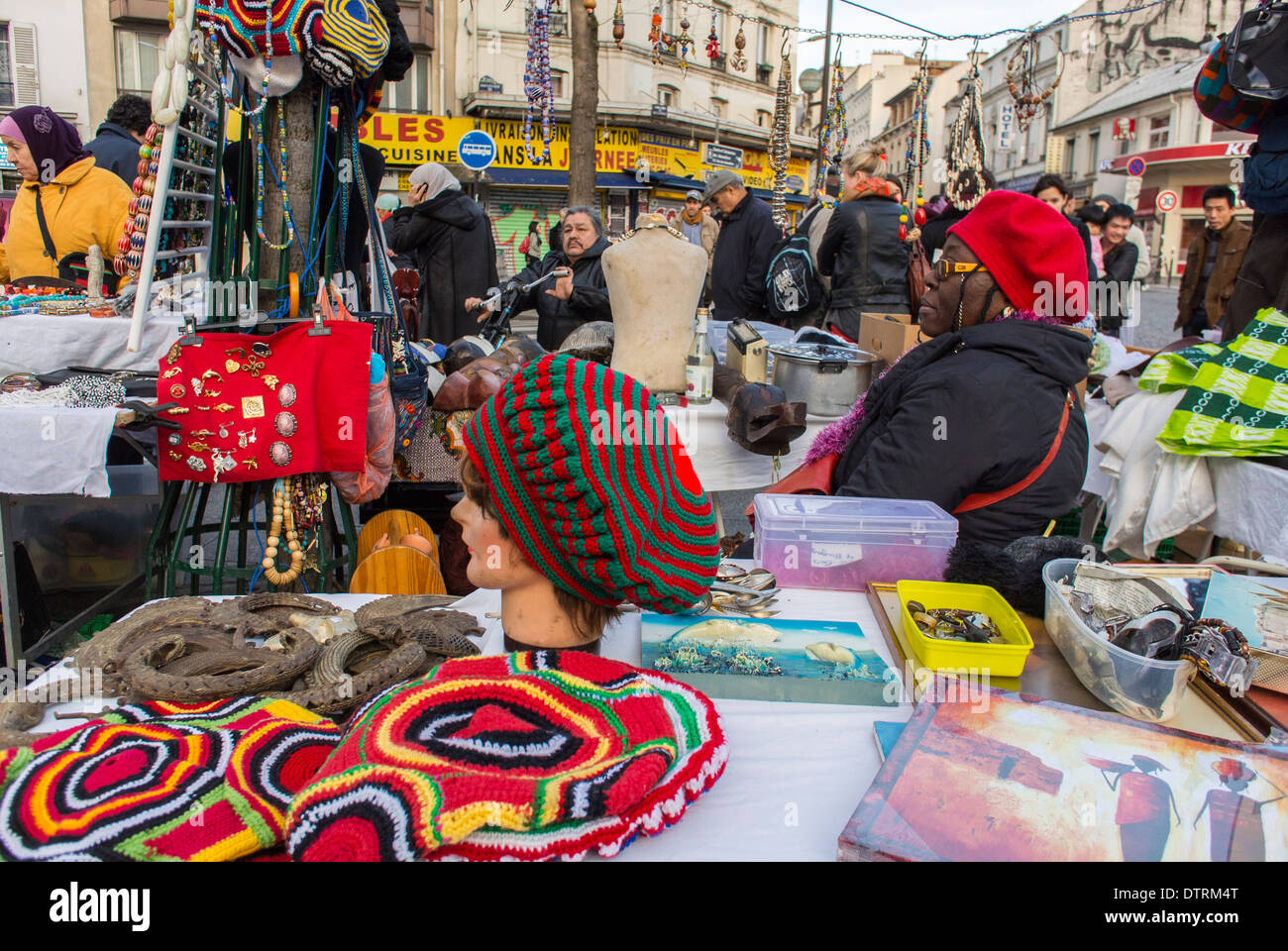 Paris, France., People Shopping French Flea Market in Belleville Area, African Woman Selling Hand Made Fashion Products, Knit Hats - Stock Image