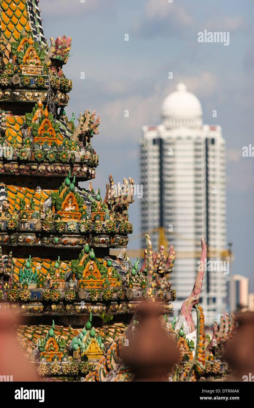 Traditional Temple and modern buildings in Bangkok, Thailand - Stock Image