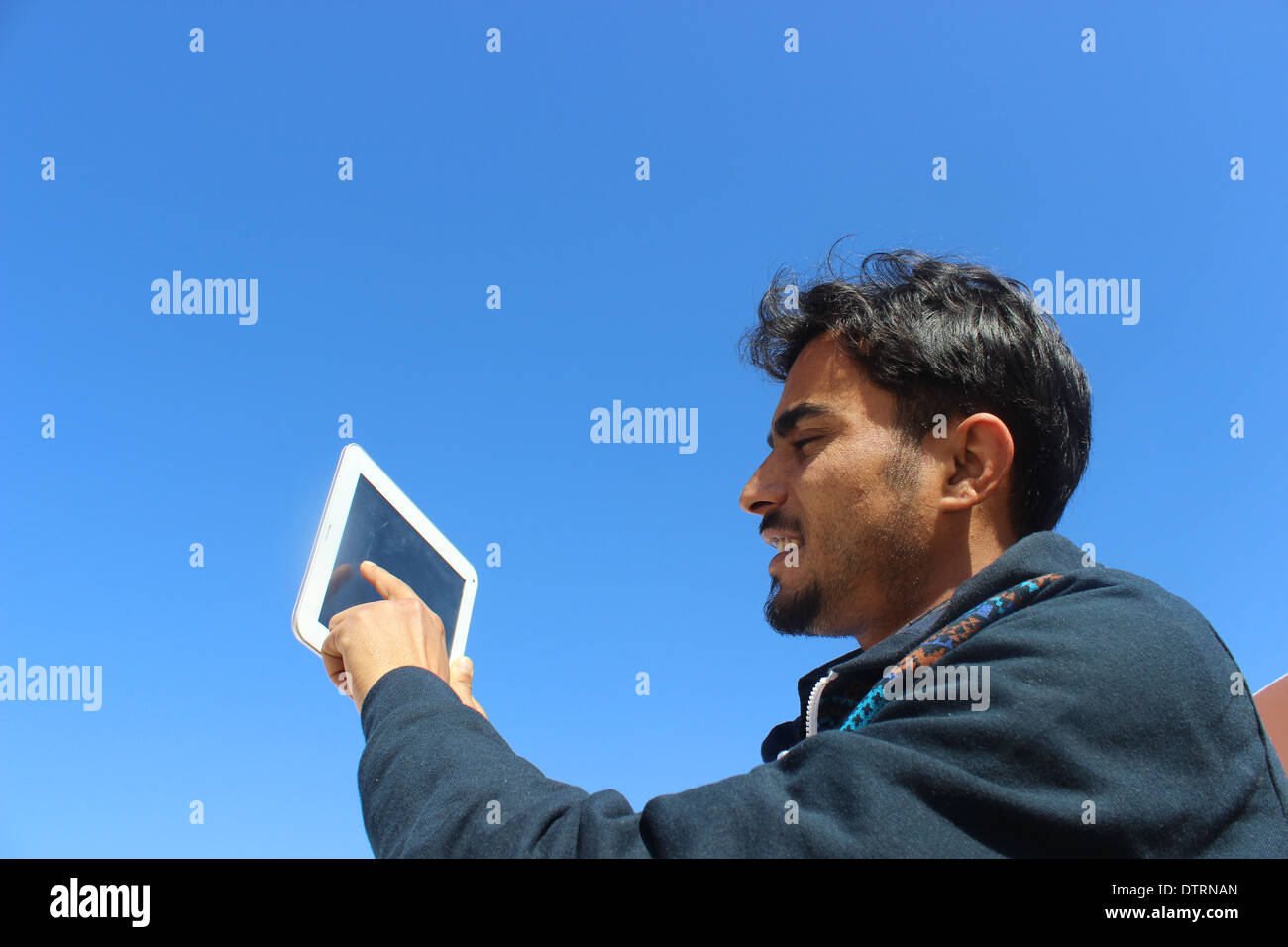 Young man with tablet - Stock Image