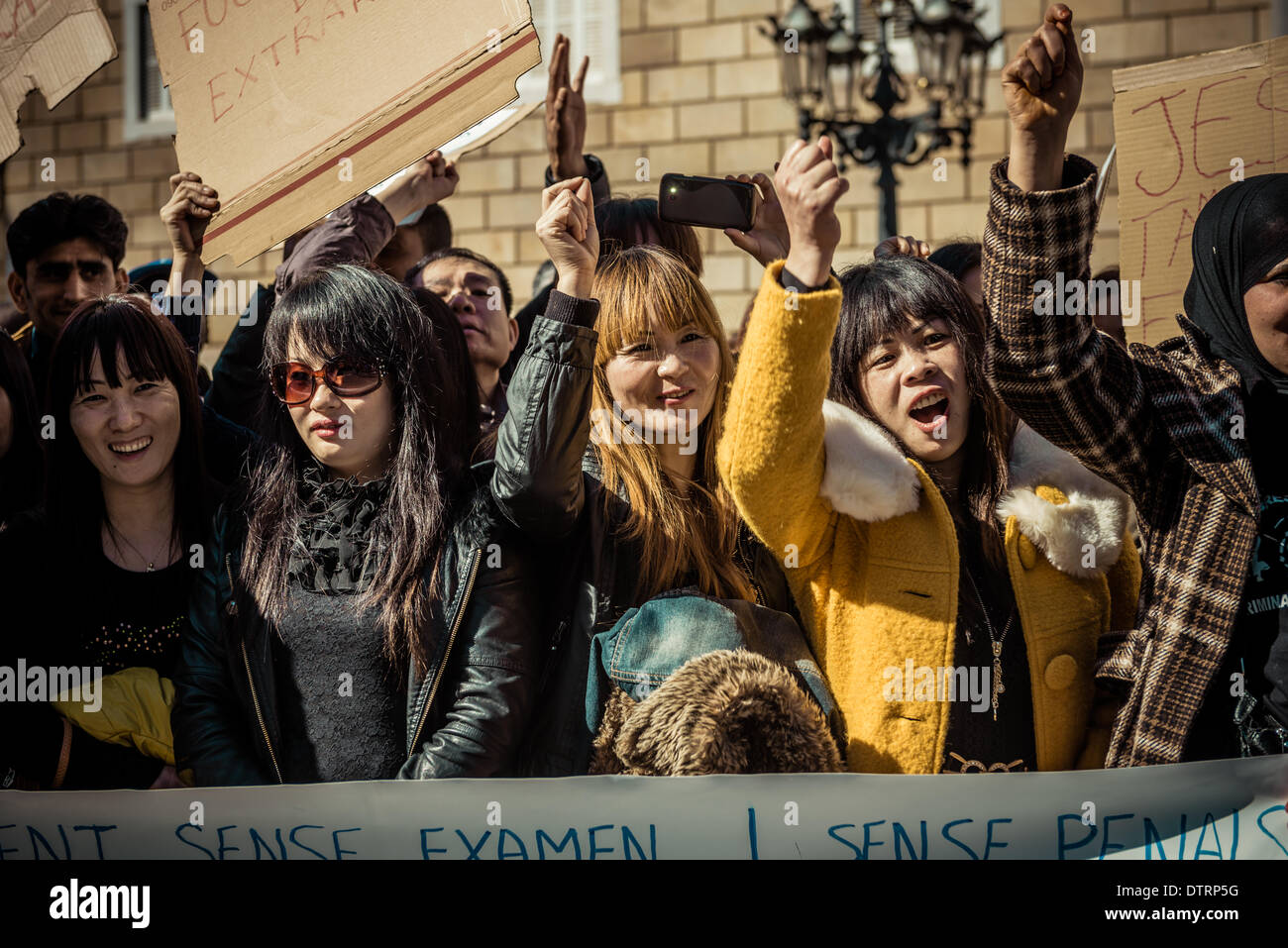 Barcelona, Spain. February 23rd, 2014: Immigrants behind their banner concentrate for immigration rights and papers Stock Photo
