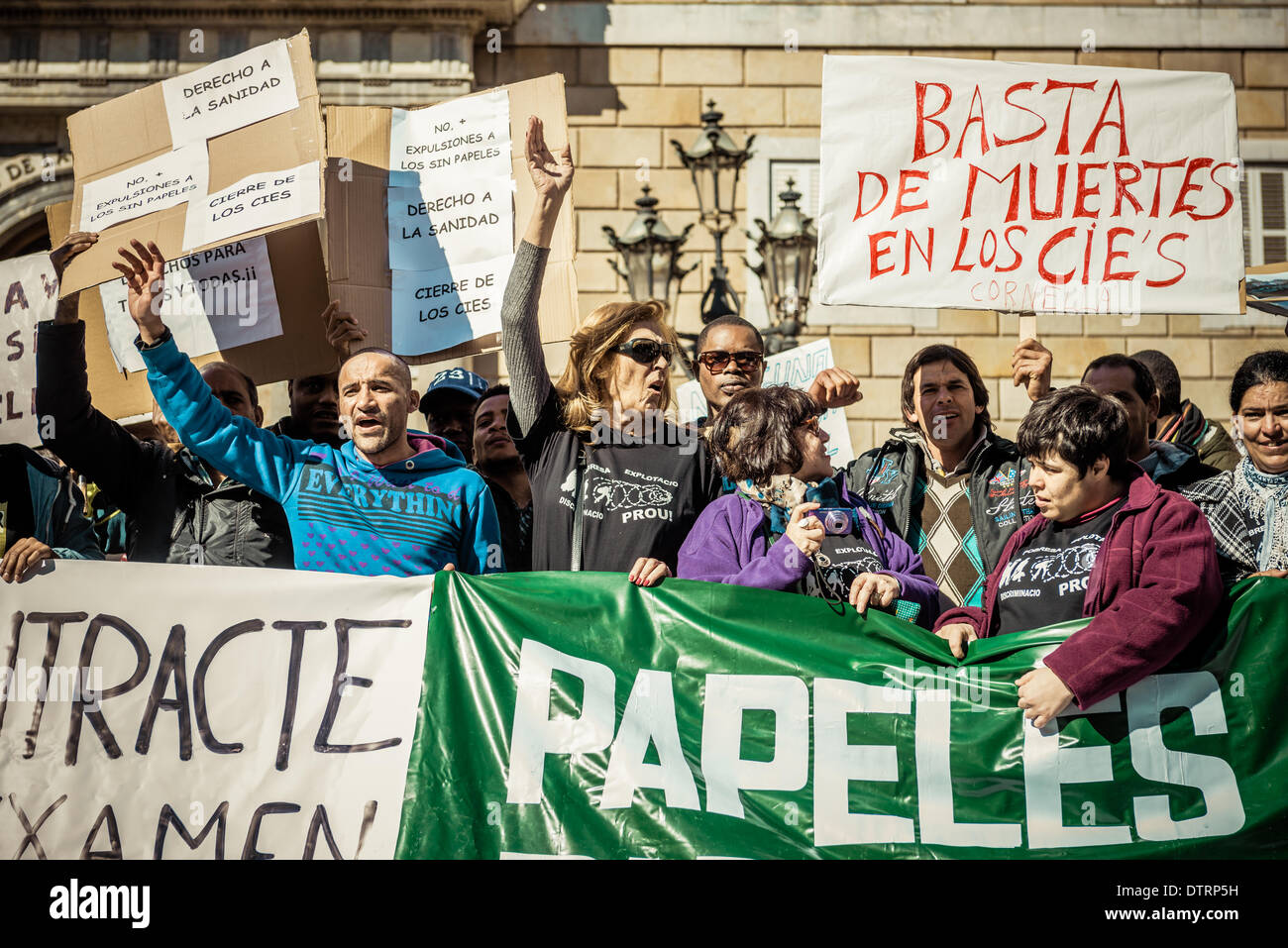 Barcelona, Spain. February 23rd, 2014: Immigrants holding placards concentrate for immigration rights and papers Stock Photo