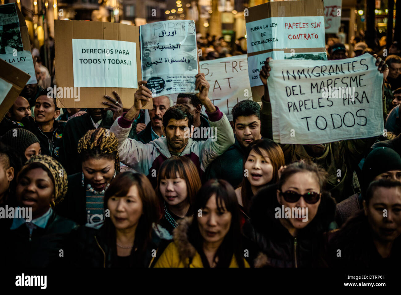 Barcelona, Spain. February 23rd, 2014: Immigrants holding placards march for immigration rights and papers through Stock Photo