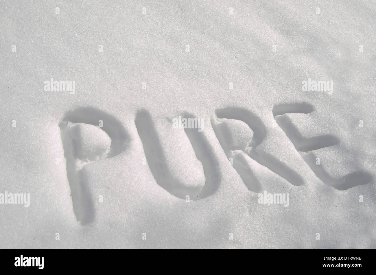 Pure written in new snow. - Stock Image