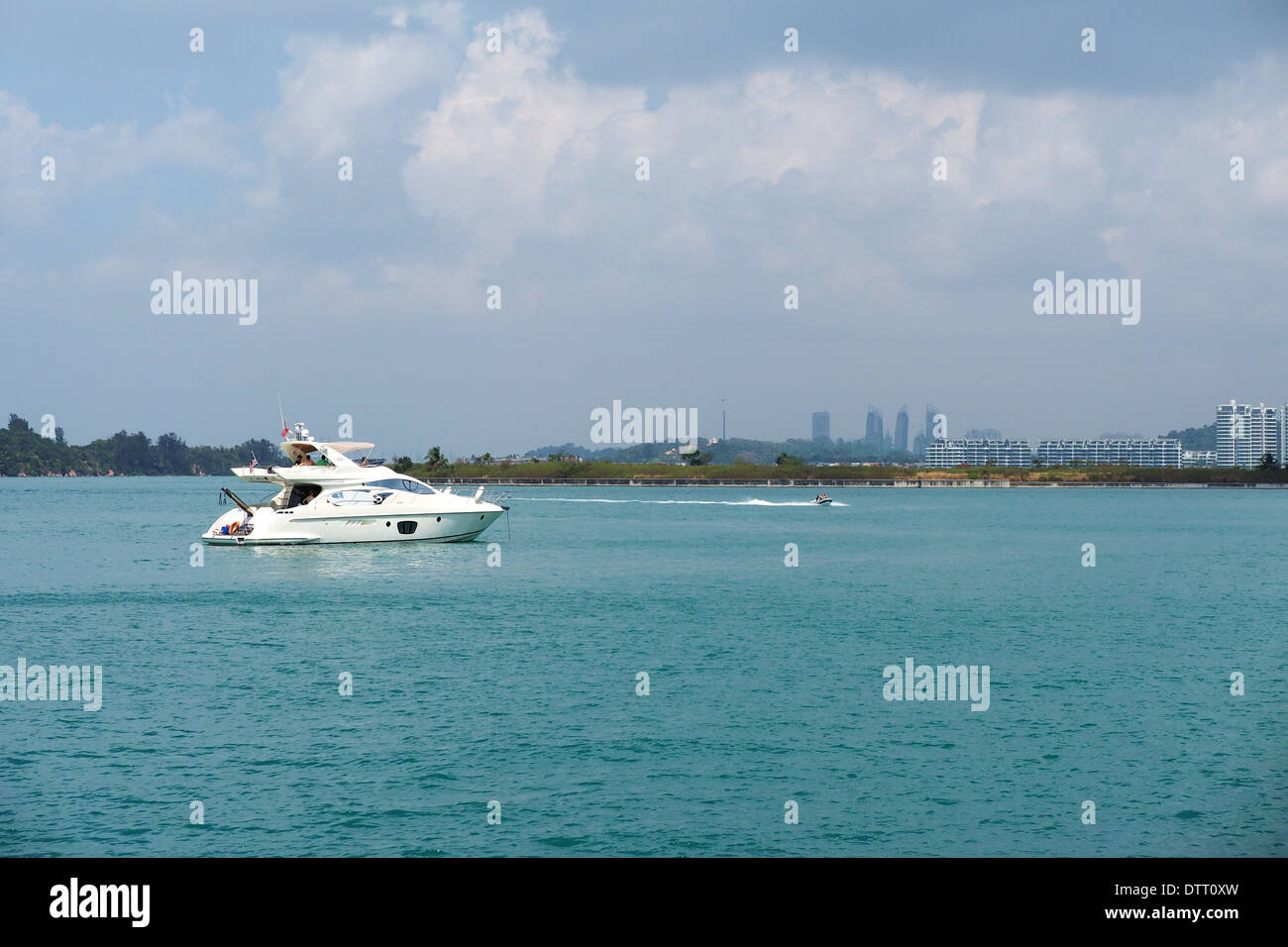 Private yacht anchored at the sheltered waters of Singapore's Southern Island - St. John's Island on a sunny afternoon - Stock Image