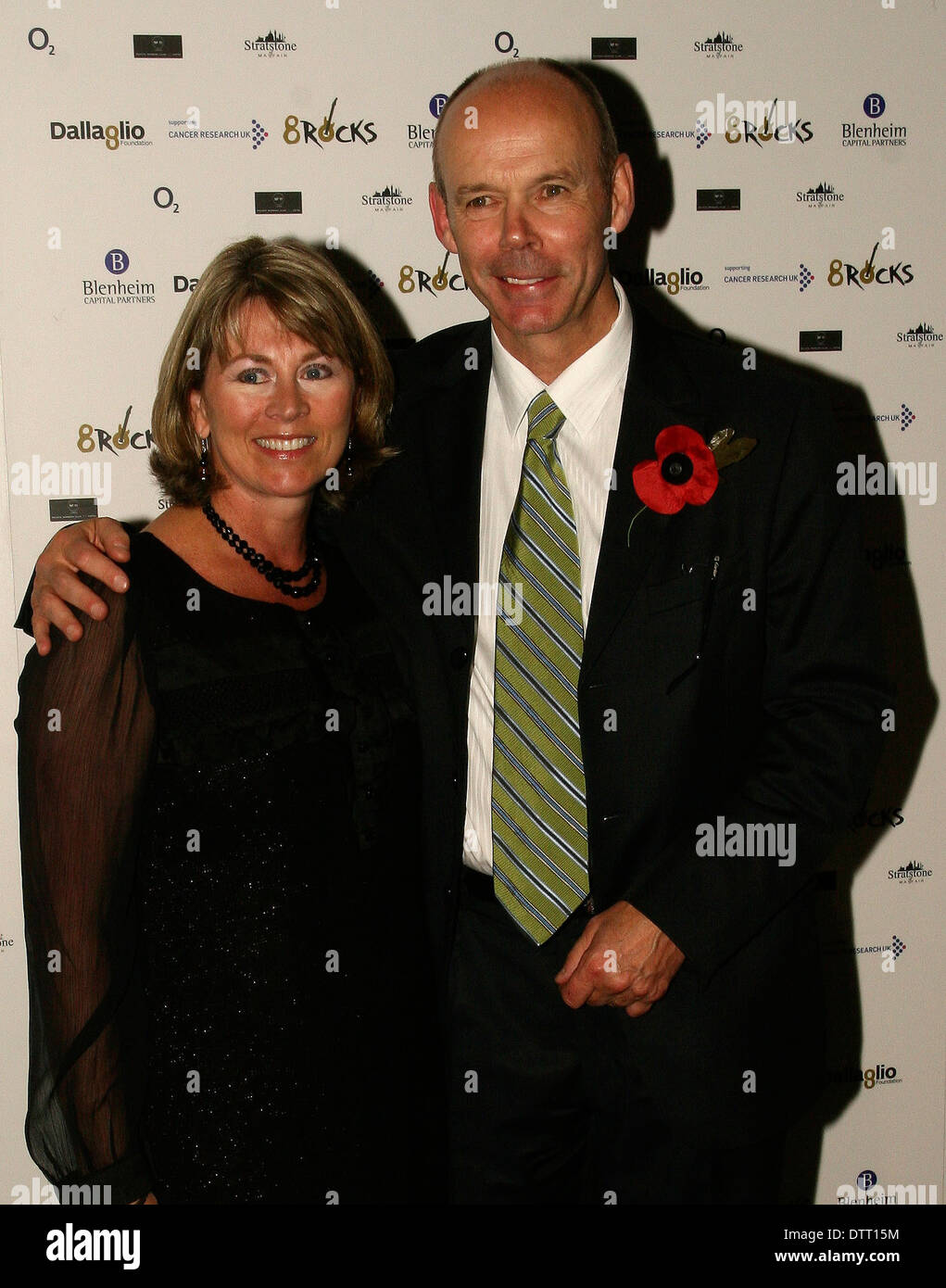 Former Rugby coach Sir Clive Woodward with wife at the Cnacer Research Charity event in London - Stock Image