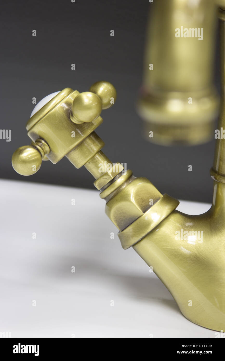 Retro-styled water bronze tap on sink Stock Photo