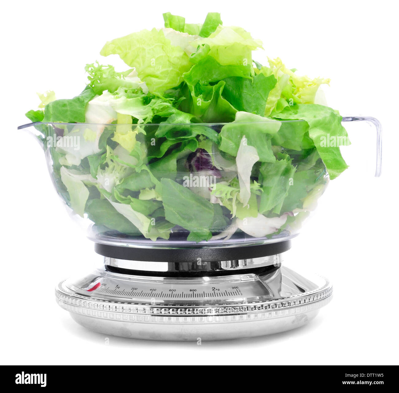 salad leaves in a scale, symbolizing the dieting concept or to stay fit - Stock Image