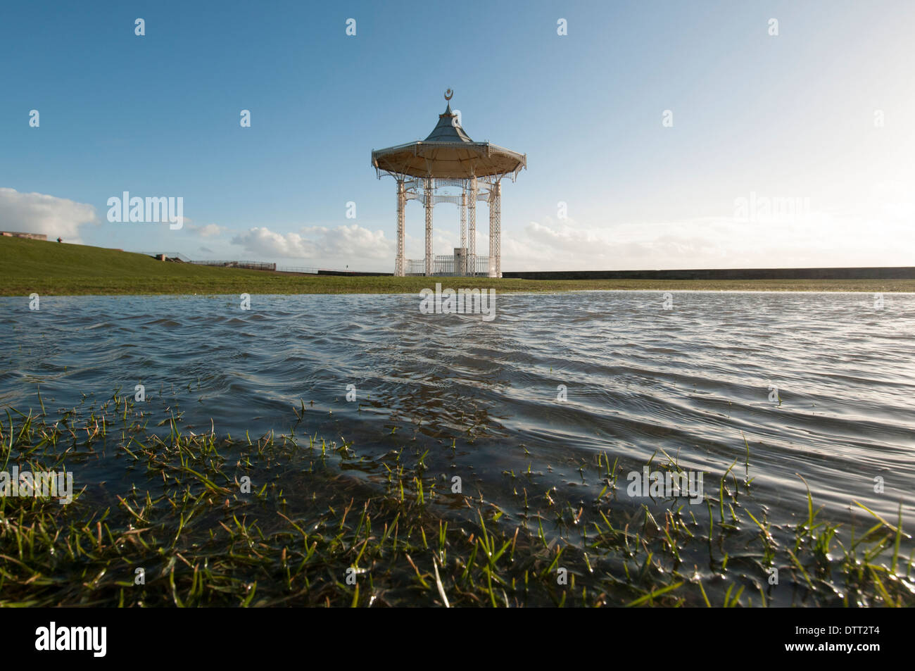 the bandstand at Southsea seafront nearly flooded with rain water after heavy winter storms Stock Photo