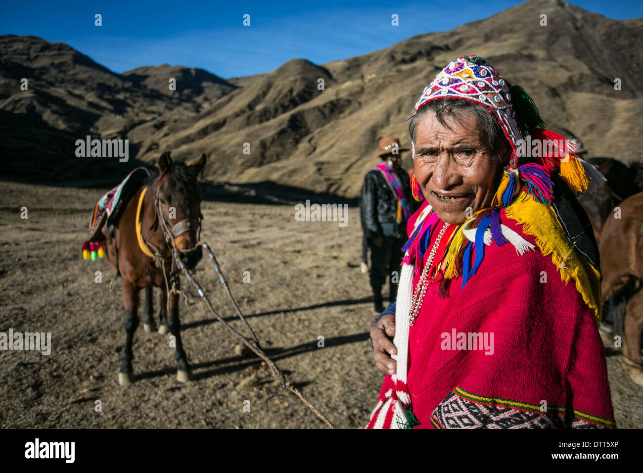 horse race in the highlands of the andes, the horseman is a old quechua speaking man dressed with his topical outfit poncho - Stock Image