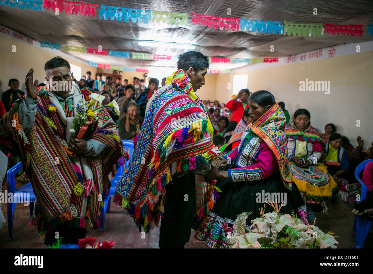 wedding in the andes among the quechua community called chillihuani - typical dresses and ponchos. - Stock Image