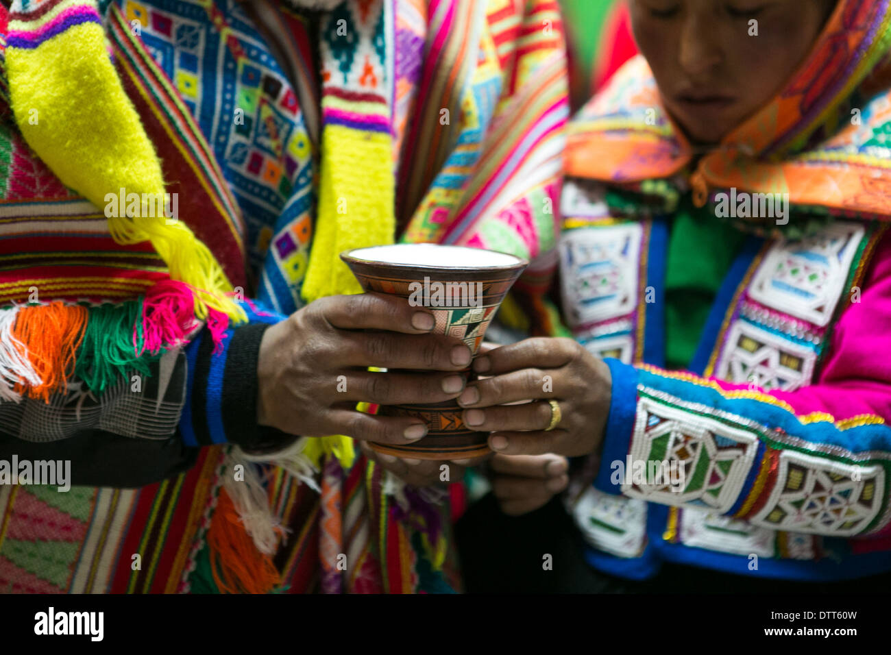 wedding in the andes among the quechua community called chillihuani - typical dresses and ponchos.close up of the goblet - Stock Image