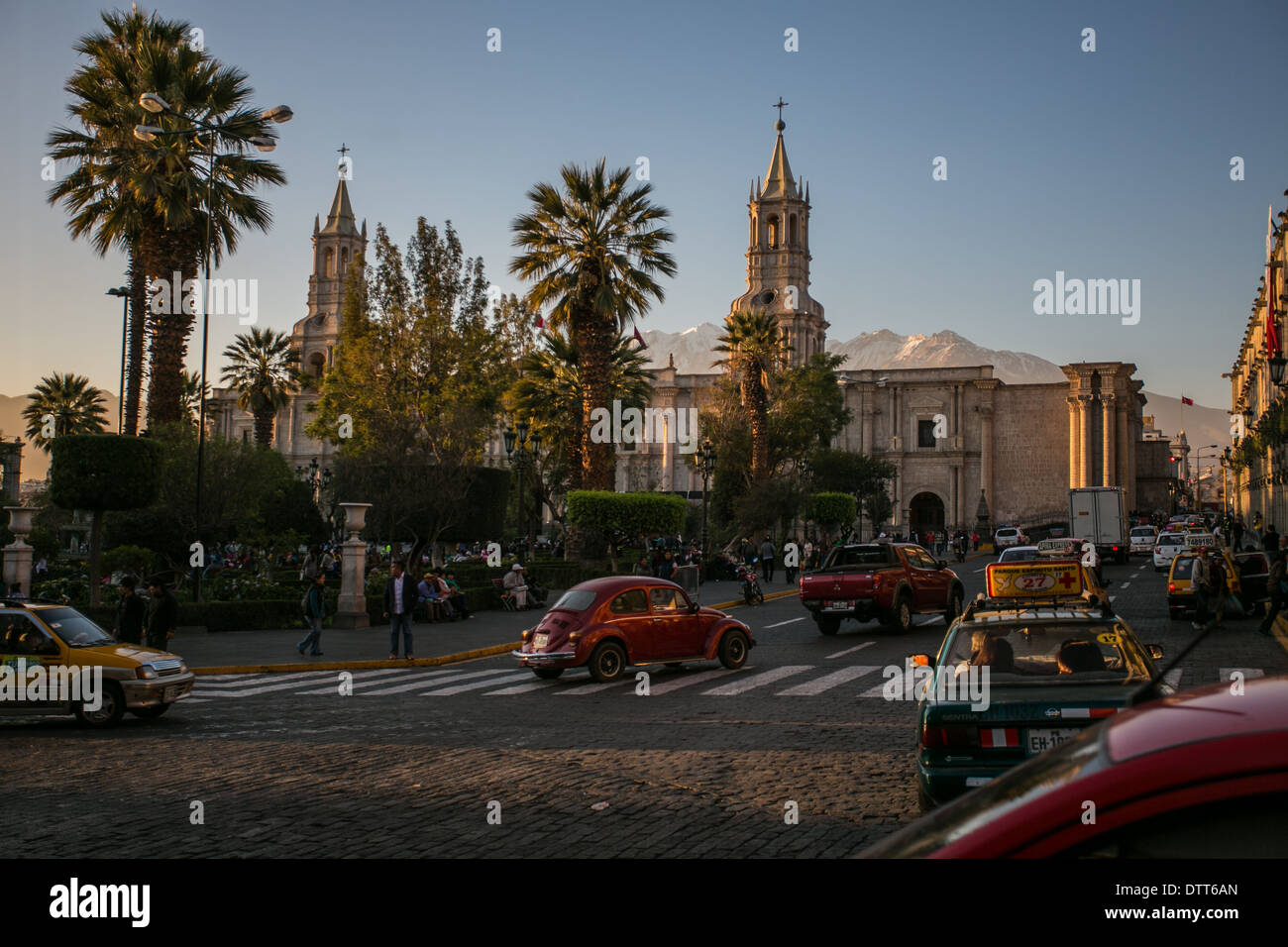 Arequipa - peru - view from hotel with reddish/ orange light from the sunset - cathedral and main square -  car passing by - Stock Image