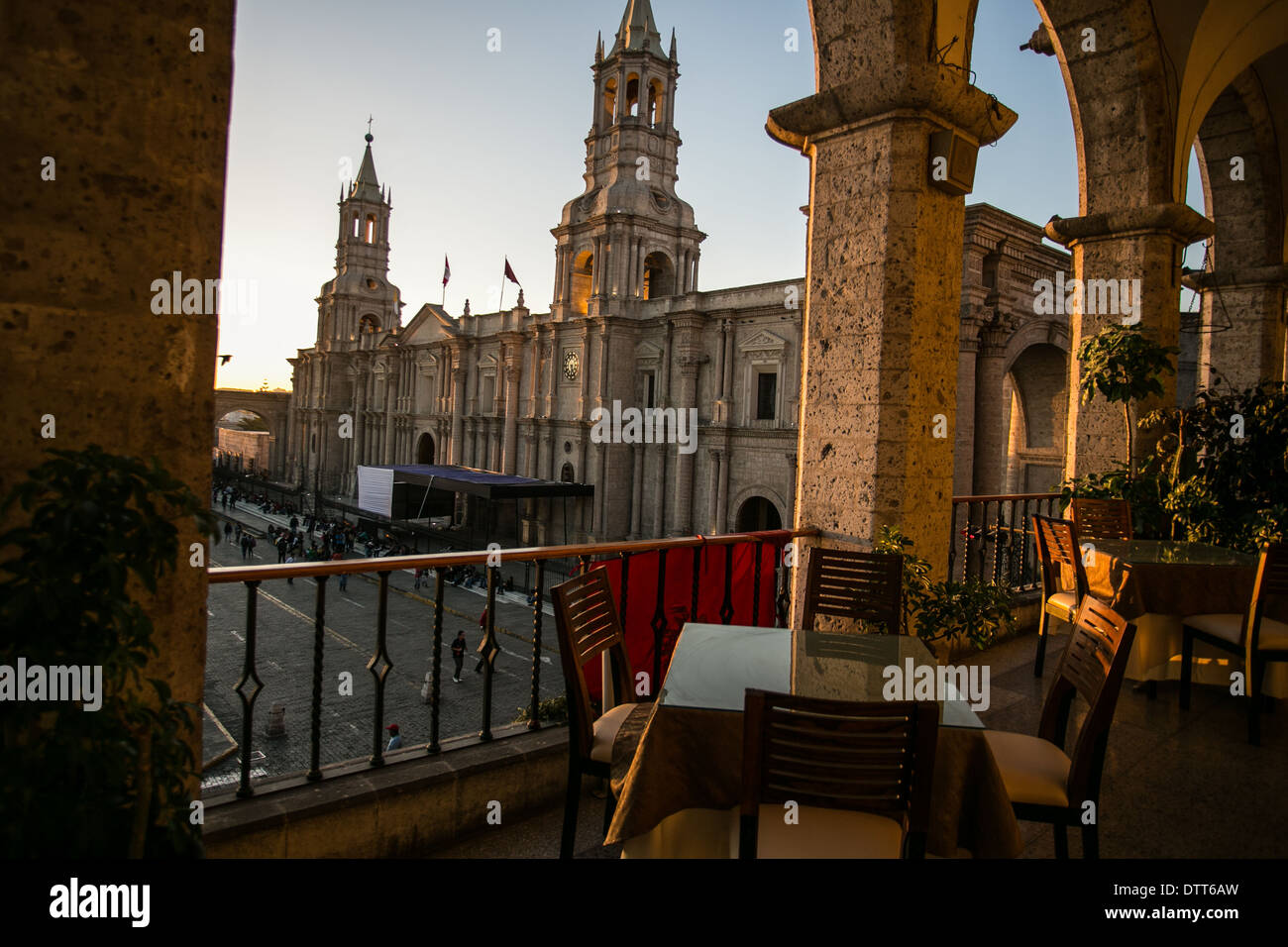 Arequipa - peru - view from hotel with reddish/ orange light from the sunset - cathedral and main square -  having lunch/dinner - Stock Image